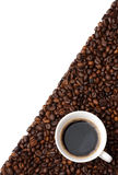 Copo em feijões de café Foto de Stock Royalty Free