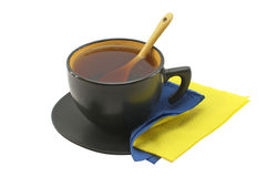 Copo preto com chá preto Fotos de Stock