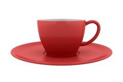 Copo vermelho e saucer cerâmicos isolados no branco Imagens de Stock Royalty Free