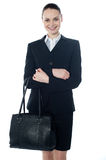 Coporate lady holding a handbag. Corporate lady holding a handbag isolated over white Royalty Free Stock Photos