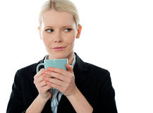 Coporate woman holding coffee mug. Isolated over white background Stock Images