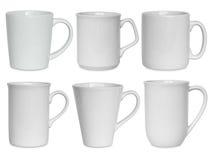 Copos brancos ajustados isolados no branco Imagem de Stock Royalty Free
