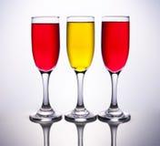 3 copos coloridos com bandeira espanhola Fotografia de Stock Royalty Free