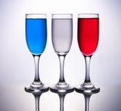 3 copos coloridos com bandeira francesa Imagens de Stock