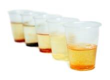 Copos com amostras de água Imagem de Stock Royalty Free