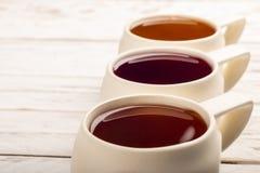 Copos com a bebida diferente de três chás Imagem de Stock