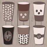 Copos de café ajustados Fotos de Stock
