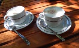 Copos de café do cappuccino Fotografia de Stock