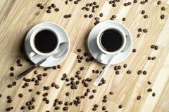 Copos de café e feijões de café Imagens de Stock Royalty Free