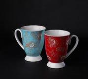 Copos de chá cianos e vermelhos Imagens de Stock
