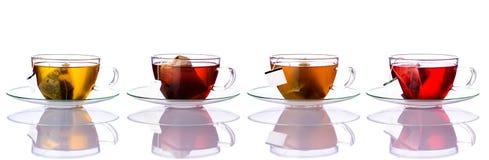 Copos de chá com os sacos na colagem Fotografia de Stock Royalty Free