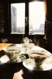 Copos de Coffe na tabela Foto de Stock Royalty Free