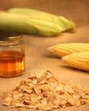 Copos de maíz con la miel Foto de archivo