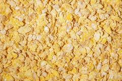 Copos de maíz fondo, porciones de avenas de oro Imagenes de archivo