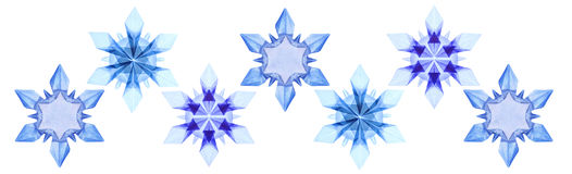 Copos de nieve azules del hielo de la papiroflexia fijados Fotografía de archivo