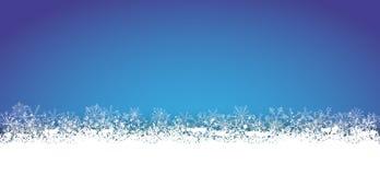 Copos de nieve azules largos de la tarjeta de Navidad stock de ilustración