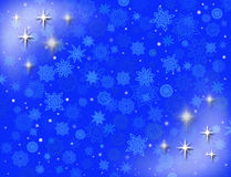 Copos de nieve blancos en el fondo azul Imagen de archivo libre de regalías