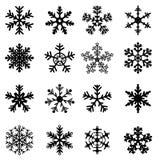 Copos de nieve blancos y negros fijados Foto de archivo
