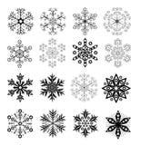 Copos de nieve blancos y negros fijados Fotografía de archivo