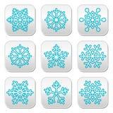 Copos de nieve, botones azules de la decoración del invierno fijados Fotos de archivo