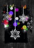 copos de nieve chispeantes del día de fiesta en marco de madera negro Foto de archivo