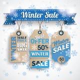 Copos de nieve de Bokeh de las etiquetas engomadas del precio de la cinta de la venta del invierno Fotografía de archivo