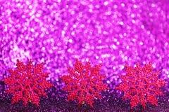 Copos de nieve decorativos púrpuras Imágenes de archivo libres de regalías