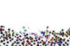 Copos de nieve del color en el fondo blanco Fotografía de archivo libre de regalías