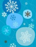 Copos de nieve en azul Fotografía de archivo
