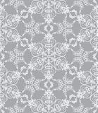 Copos de nieve en el fondo de plata Foto de archivo libre de regalías
