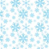 Copos de nieve en un fondo blanco Fotografía de archivo