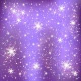 Copos de nieve en un fondo de la lila Fotografía de archivo libre de regalías