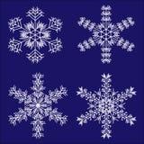 Copos de nieve fijados stock de ilustración