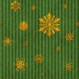Copos de nieve inconsútiles del oro en raya verde Imagen de archivo