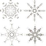 Copos de nieve negros en un fondo blanco Imagen de archivo libre de regalías