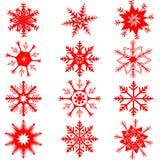 Copos de nieve rojos en el fondo blanco Fotos de archivo libres de regalías