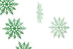 Copos de nieve verdes Fotografía de archivo libre de regalías