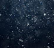 Copos de nieve y estrellas que caen Fotos de archivo libres de regalías