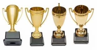Copos do ouro dos vencedores Fotografia de Stock Royalty Free