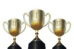 Copos do troféu para primeiramente, segundos e terceiros lugares imagens de stock royalty free