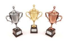 Copos dourados, de prata e de bronze do troféu no fundo branco 3d com referência a Fotos de Stock Royalty Free