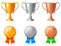 Copos e medalhas do troféu. Foto de Stock