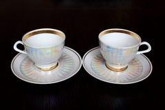 Copos e pires de chá Fotografia de Stock Royalty Free