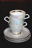Copos e pires de chá Foto de Stock