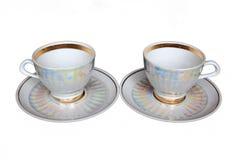 Copos e pires de chá isolados Fotos de Stock Royalty Free