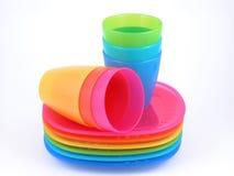 Copos e placas plásticos Imagem de Stock Royalty Free