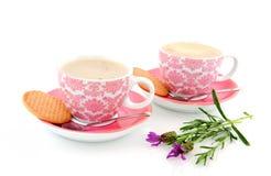 Copos e saucers cor-de-rosa alegres Imagens de Stock