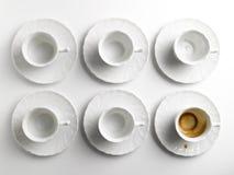 Copos e saucers de café Imagem de Stock Royalty Free