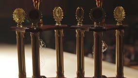Copos para conceder líderes da competição, melhor classificação superior, maneira bem sucedida de sonhar video estoque