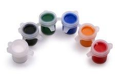 Copos plásticos pequenos com pintura Imagem de Stock Royalty Free